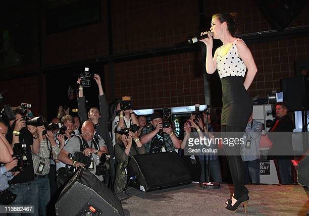 Singer Lena MeyerLandrut performs at a party at Rudas Studios the day before the first semifinals of the Eurovision Song Contest 2011 on May 9 2011...