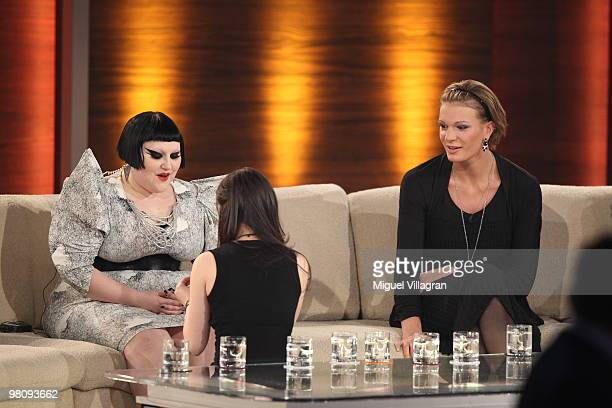 Singer Lena MeyerLandrut sits on her knees in front of singer Beth Ditto during the 188th 'Wetten dass ' show at Messezentrum Salzburg on March 27...