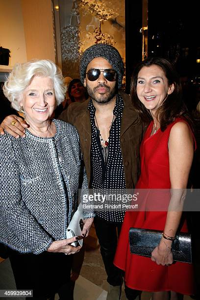 Singer Lenny Kravitz standing between owner of Longchamp Michele Cassegrain and her daughter Arts Director of Longchamp Sophie Delafontaine attend...