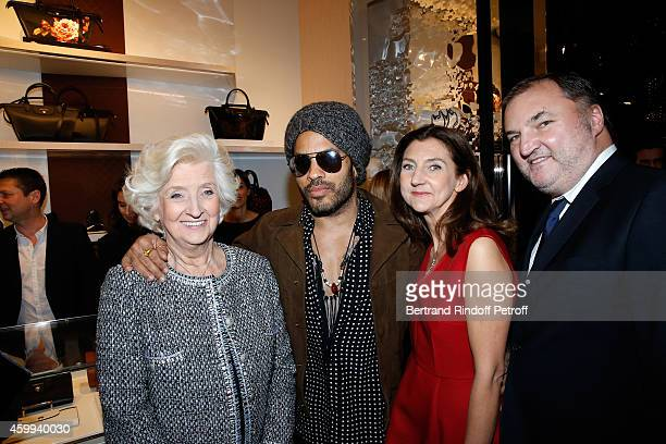 Singer Lenny Kravitz standing between owner of Longchamp Michele Cassegrain her daughter Arts Director of Longchamp Sophie Delafontaine and her son...