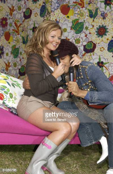 Singer Lenny Kravitz with Channel 5 presenter for the day Geri Halliwell backstage at '958 Capital FM's Party In The Park For The Prince's Trust' on...