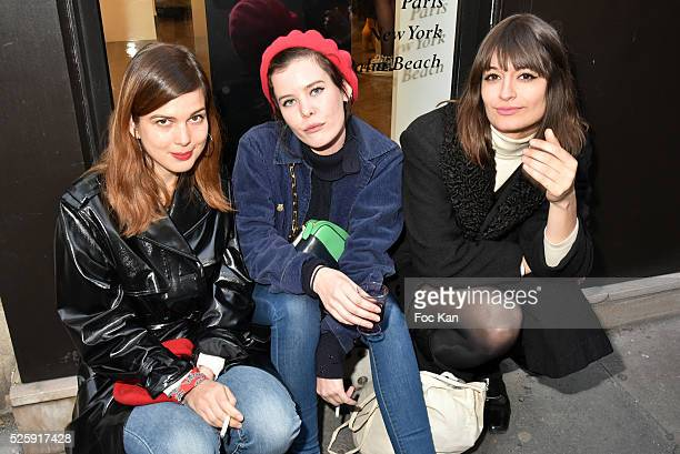 singer Leonie Popo actress Lou Lesage and singer Clara Luciani attend the 'As Hard' Pierre Emery Paintings /Collages Exhibition at Galerie...