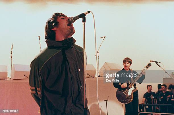 Singer Liam Gallagher and his brother guitarist Noel Gallagher performing with British rock band Oasis on Channel 4's live music TV show 'The White...