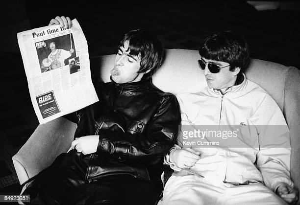Singer Liam Gallagher of Manchester rock band Oasis sticks his tongue out at a picture in the New Musical Express of rival Mancunian frontman Ian...