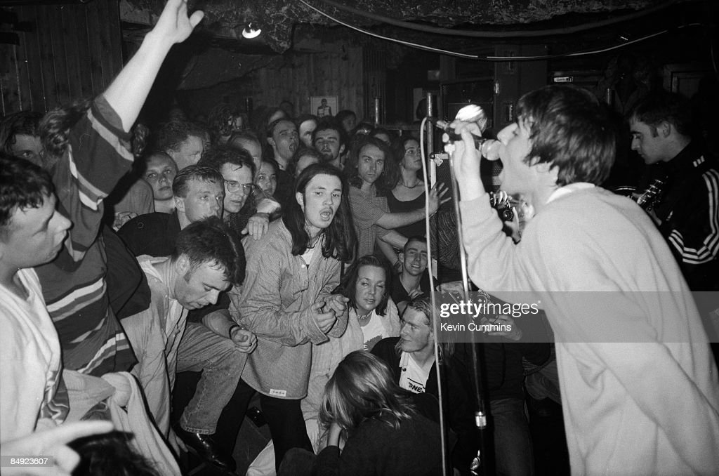 Singer Liam Gallagher performing with British rock group Oasis in Portsmouth, 2nd May 1994.