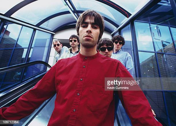 Singer Liam Gallagher with the other members of British pop group Oasis 2nd August 1994 From left to right rhythm guitarist Paul 'Bonehead' Arthurs...