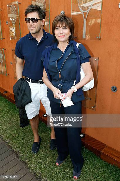 Singer Liane Foly and agent Laurent Baron sighting at Roland Garros Tennis French Open 2013 Day 14 on June 8 2013 in Paris France