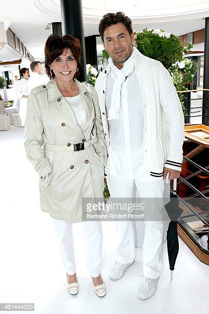 Singer Liane Foly and her manager Laurent Baron attend the 'Brunch Blanc' hosted by Barriere Group on June 29 2014 in Paris France
