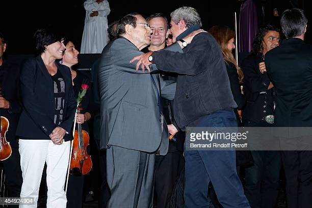Singer Liane Foly director Robert Hossein Actor Francis Huster and director Claude Lelouch on stage at the end of the 'Claude Lelouch en Musique Held...