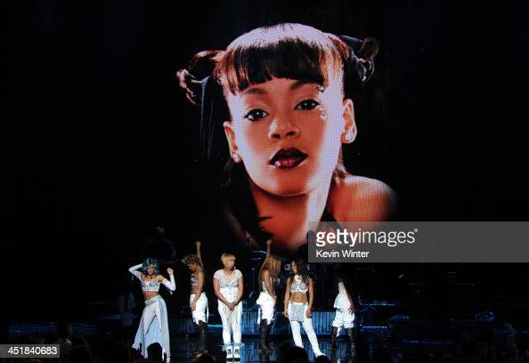 Singer Lil Mama performs with singers Tionne 'TBoz' Watkins and Rozonda 'Chilli' Thomas of TLC onstage during the 2013 American Music Awards at Nokia...