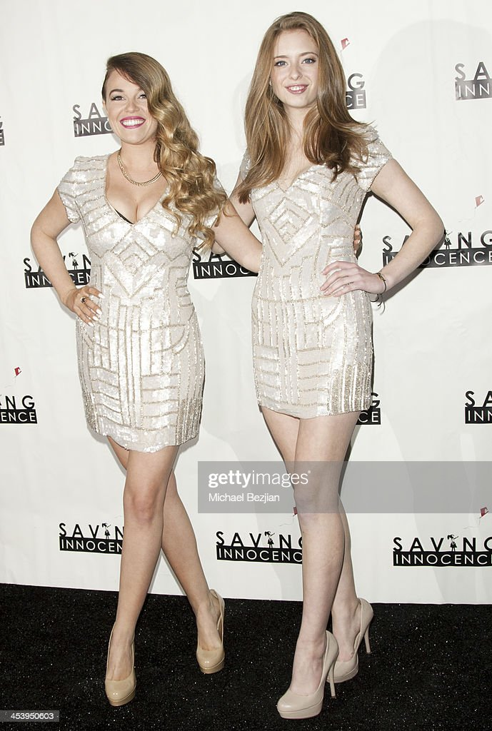 Singer Lilly Elise and actress Ashlyn Pearce arrive at the 2nd Annual Saving Innocence Gala Hosted By Kellan Lutz And Keke Palmer - Arrivals at The Crossing on December 5, 2013 in Los Angeles, California.