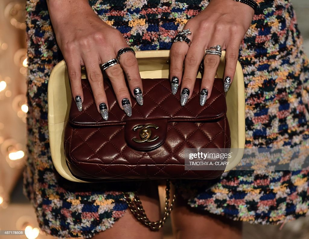 Singer Lily Allen arrives for the Chanel dinner celebrating the debut screening of ' N°5 The Film ' by Baz Luhrmann in New York October 13 2014 AFP...