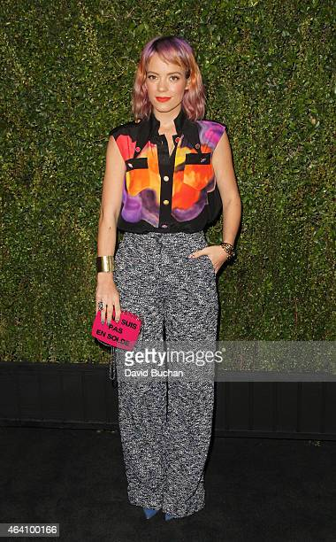 Singer Lily Allen attends the Chanel and Charles Finch PreOscar Dinner at Madeo Restaurant on February 21 2015 in Los Angeles California
