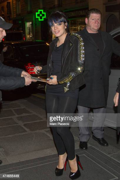 Singer Lily Allen signs autographs as she arrives at the 'Bristol' hotel on February 24 2014 in Paris France