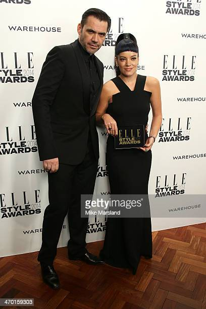 Singer Lily Allen winner of the UK Recording Artist of the Year poses with designer Roland Mouret in the winners room at the Elle Style Awards 2014...