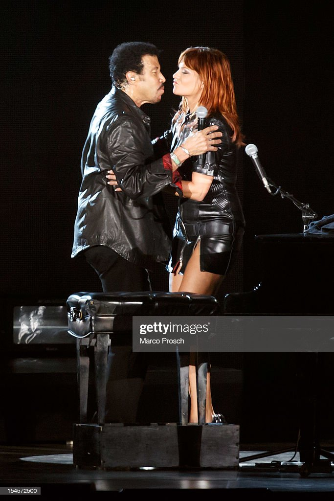 US singer Lionel Richie (L) and German singer Andrea Berg (R) hug after singing together at the Arena on October 22, 2012 in Leipzig, Germany.