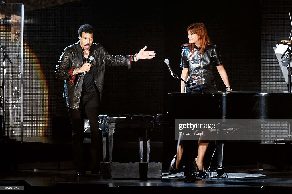 US singer Lionel Richie (L) and German singer Andrea Berg (R) perform live together at the Arena on October 22, 2012 in Leipzig, Germany.