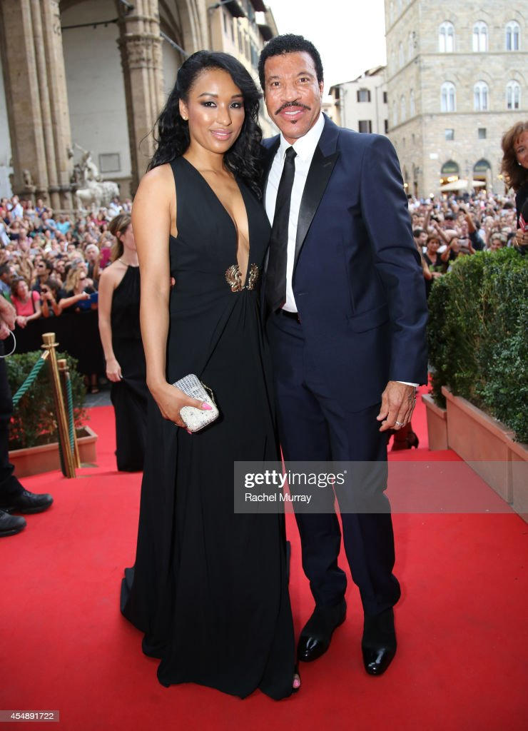 Singer Lionel Richie and Lisa Parigi attend the Celebrity Fight Night gala celebrating Celebrity Fight Night In Italy benefitting The Andrea Bocelli Foundation and The Muhammad Ali Parkinson Center on September 7, 2014 in Florence, Italy.