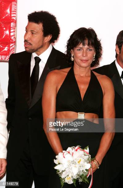 Singer Lionel Richie and Princess Stephanie of Monaco arrive at the Monte Carlo Red Cross Ball 2004 held at the Salle des Etoiles of the Monaco...