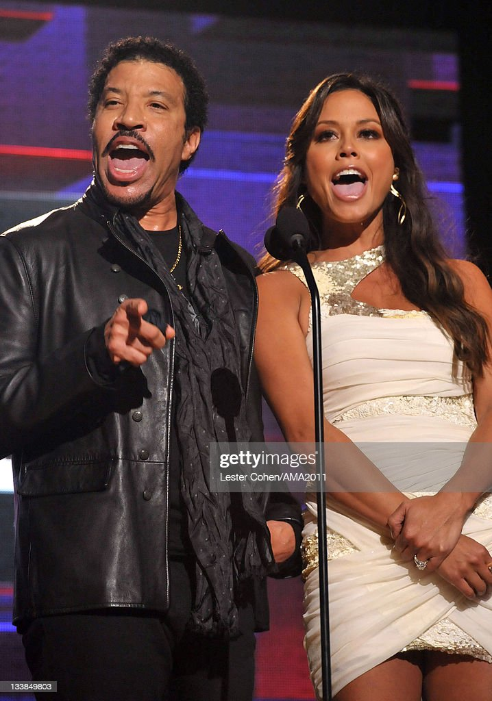 Singer <a gi-track='captionPersonalityLinkClicked' href=/galleries/search?phrase=Lionel+Richie&family=editorial&specificpeople=204139 ng-click='$event.stopPropagation()'>Lionel Richie</a> (L) and TV personality <a gi-track='captionPersonalityLinkClicked' href=/galleries/search?phrase=Vanessa+Minnillo&family=editorial&specificpeople=201987 ng-click='$event.stopPropagation()'>Vanessa Minnillo</a> onstage at the 2011 American Music Awards held at Nokia Theatre L.A. LIVE on November 20, 2011 in Los Angeles, California.