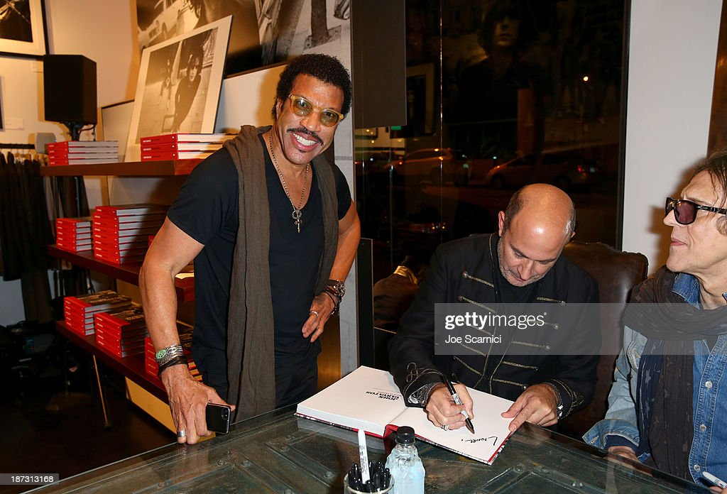 Singer Lionel Richie; designer/author John Varvatos; photographer Mick Rock attend the 'John Varvatos: Rock In Fashion' book launch celebration held at John Varvatos Los Angeles on November 7, 2013 in Los Angeles, California.