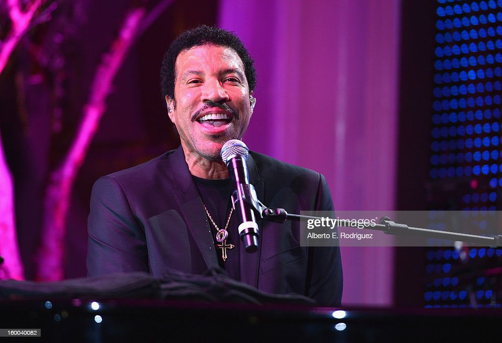 Singer <a gi-track='captionPersonalityLinkClicked' href=/galleries/search?phrase=Lionel+Richie&family=editorial&specificpeople=204139 ng-click='$event.stopPropagation()'>Lionel Richie</a> performs at The Voice Health Institute's 'Raise Your Voice' benefit at the Beverly Hills Hotel on January 24, 2013 in Beverly Hills, California.