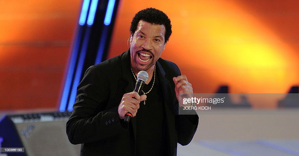 US singer Lionel Richie performs during the television show 'Wetten, dass..?' (Let's Make a Bet) at the 'Coliseo Balear' bull fighting arena in Palma de Mallorca on the Balaeric Island of Mallorca on May 23, 2010.