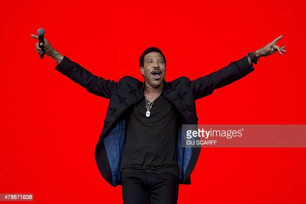 US singer Lionel Richie performs on the Pyramid Stage at the Glastonbury Festival of Music and Performing Arts on Worthy Farm near the village of...