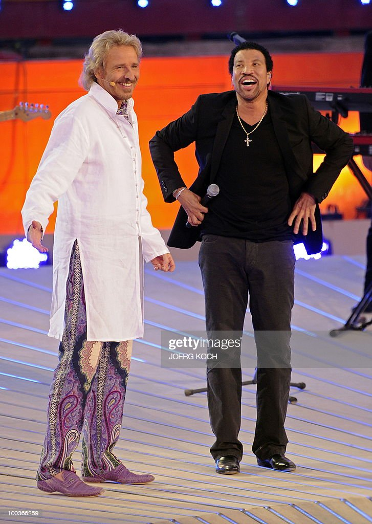 US singer Lionel Richie (R) shares a laugh with German tv-host Thomas Gottschalk after performing during the television show 'Wetten, dass..?' (Let's Make a Bet) at the 'Coliseo Balear' bull fighting arena in Palma de Mallorca on the Balaeric Island of Mallorca on May 23, 2010.
