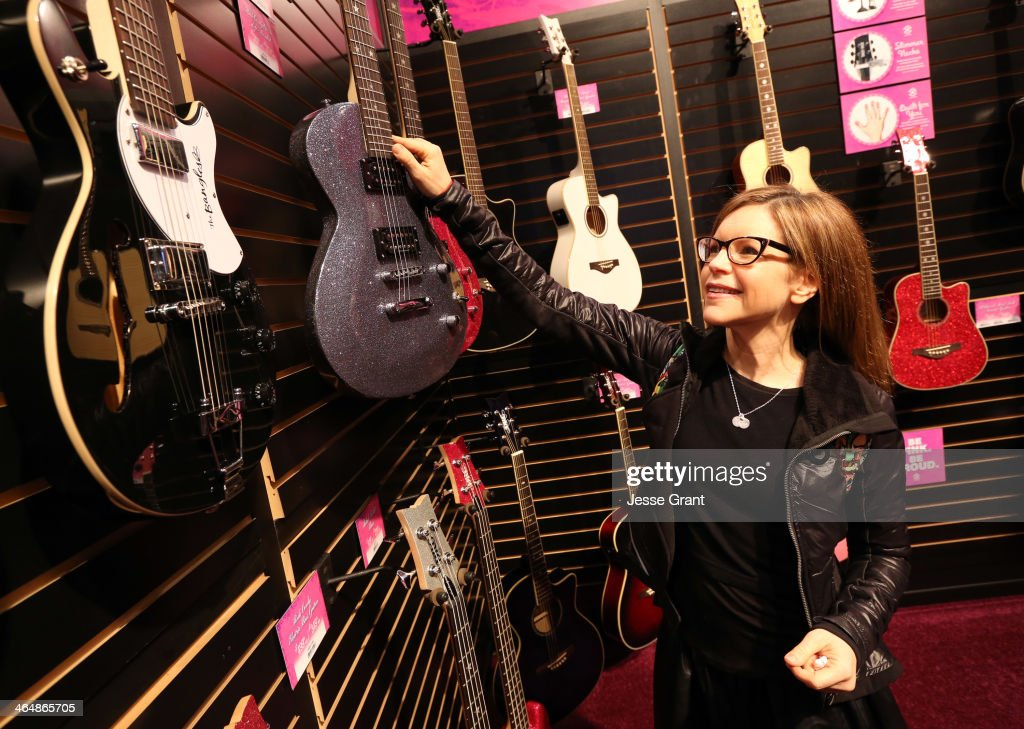 Singer <a gi-track='captionPersonalityLinkClicked' href=/galleries/search?phrase=Lisa+Loeb&family=editorial&specificpeople=718615 ng-click='$event.stopPropagation()'>Lisa Loeb</a> attends the 2014 National Association of Music Merchants show at the Anaheim Convention Center on January 24, 2014 in Anaheim, California.