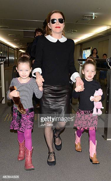 Singer Lisa Marie Presley with her twin daughters Harper Vivienne Ann and Finley Aaron Love arrive at Narita International Airport on April 5 2014 in...