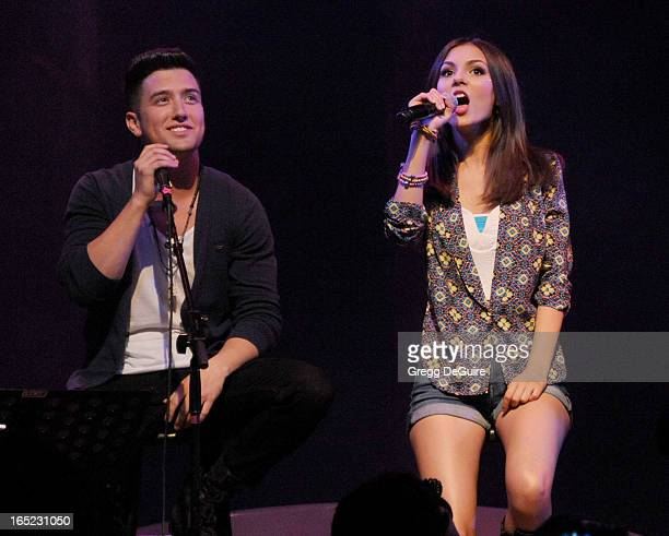 Singer Logan Henderson of Big Time Rush and Victoria Justice perform at their press conference and tour announcement at House of Blues on April 1...