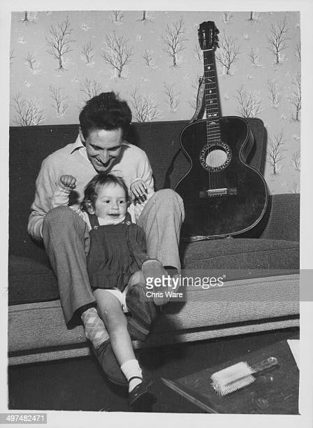 Singer Lonnie Donegan with his daughter Fiona at their home January 1959