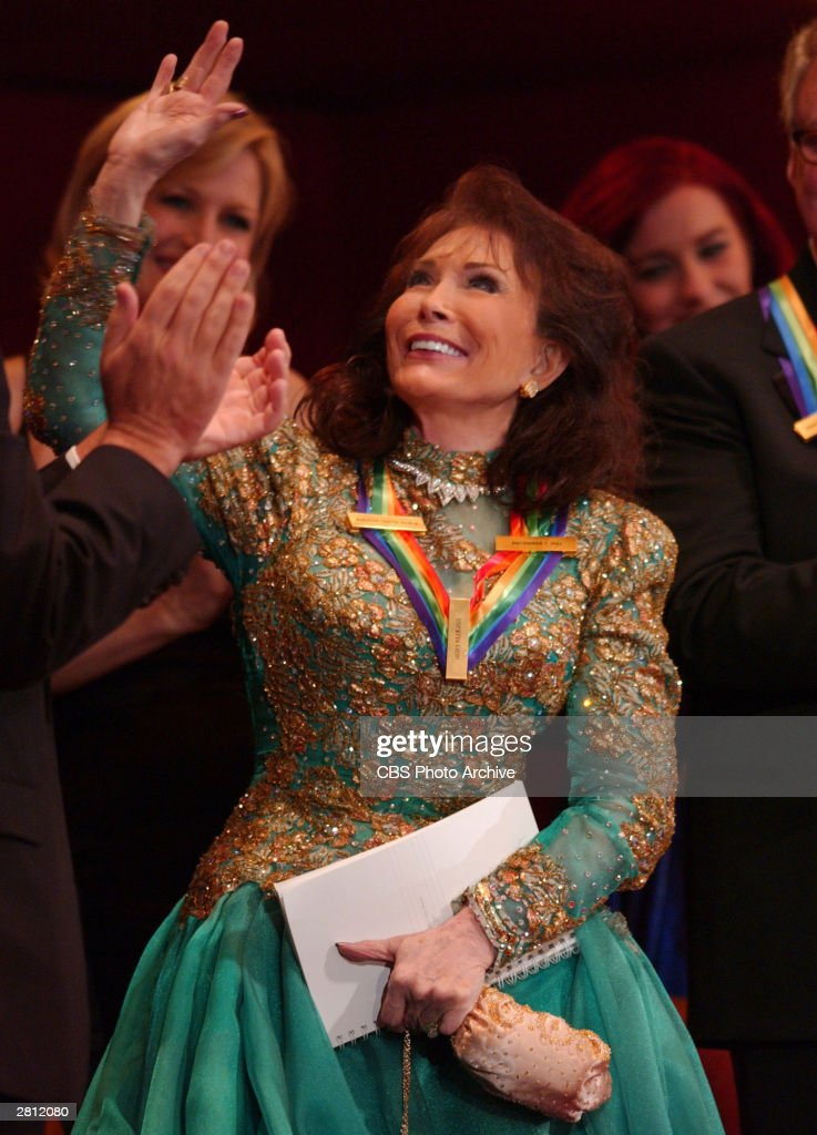 Singer Loretta Lynn, one of this year's five honorees, acknowledges the applause following her tribute at THE 26TH
