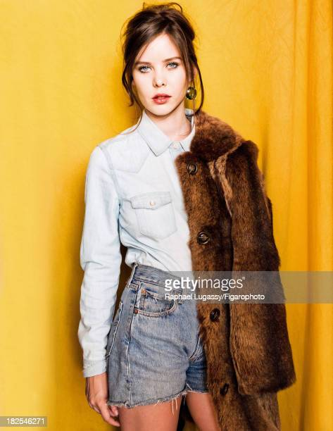 107463008 Singer Lou Lesage is photographed for Madame Figaro on July 19 2013 in Paris France Coat shirt shorts earrings CREDIT MUST READ Raphael...