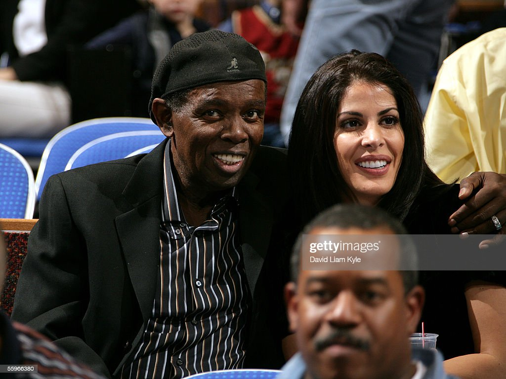 Singer Lou Rawls and wife Nina Malek Inman enjoy a preseason game between the Cleveland Cavaliers and the Memphis Grizzlies at Quicken Loans Arena on October 19, 2005 in Cleveland, Ohio.