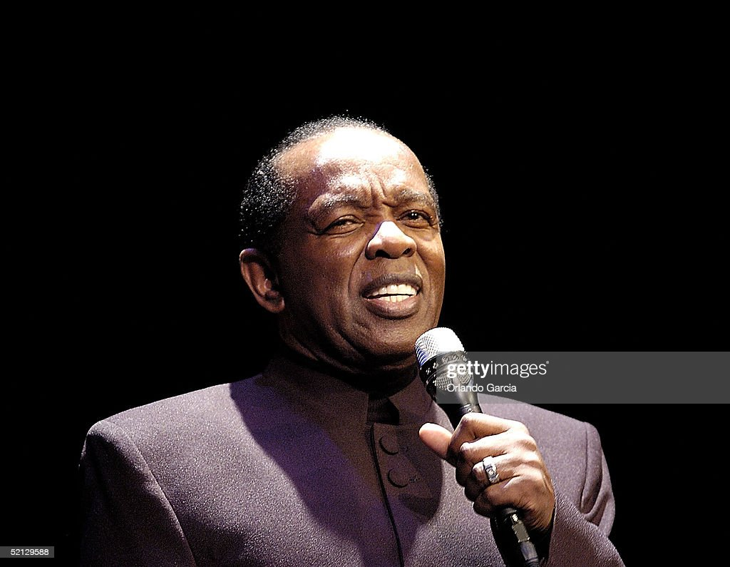 Singer Lou Rawls performs at the inaugural event for the Lou Rawls Center For The Performing Arts located at Florida Memorial College on February 3, 2005 in Miami, Florida.