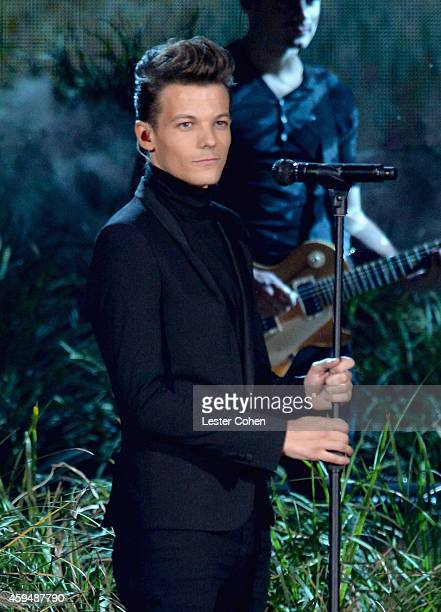 Singer Louis Tomlinson of One Direction performs onstage at the 2014 American Music Awards at Nokia Theatre LA Live on November 23 2014 in Los...
