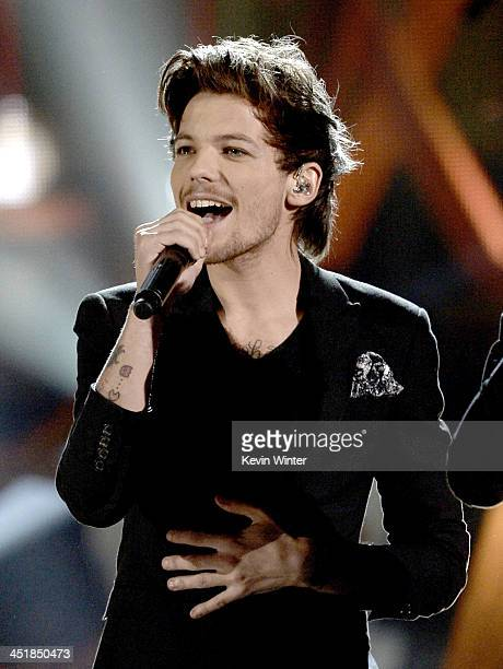 Singer Louis Tomlinson of One Direction performs onstage during the 2013 American Music Awards at Nokia Theatre LA Live on November 24 2013 in Los...