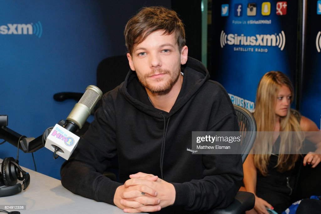 Singer Louis Tomlinson of the band One Direction visits 'The Morning Mash Up' on SiriusXM Hits 1 Channel at SiriusXM Studios on July 31, 2017 in New York City.