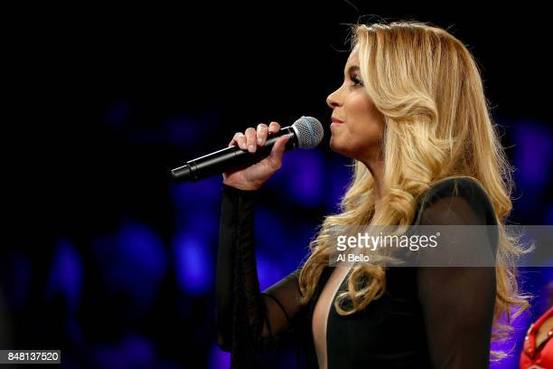 Singer Lucero performs the national anthem of Mexico before Canelo Alvarez takes on Gennady Golovkin during their WBC WBA and IBF middleweight...