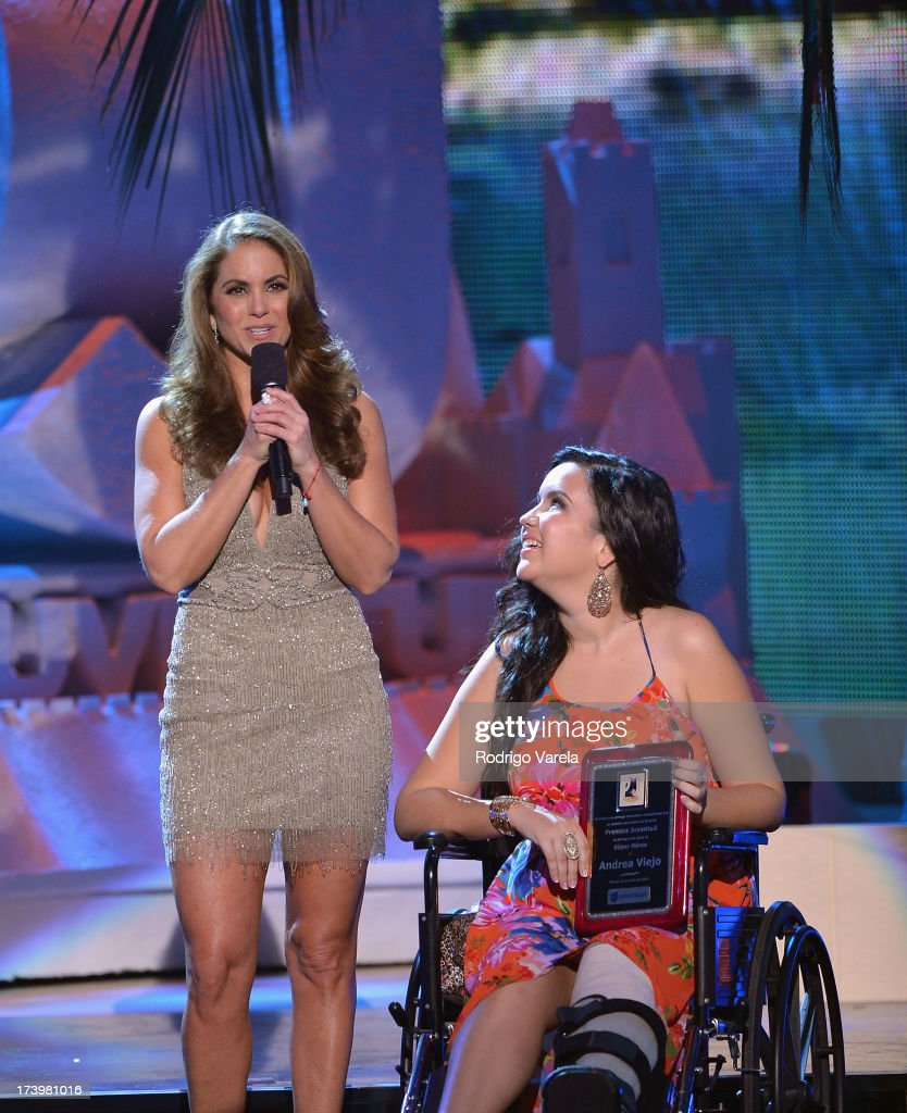 Singer <a gi-track='captionPersonalityLinkClicked' href=/galleries/search?phrase=Lucero&family=editorial&specificpeople=4680283 ng-click='$event.stopPropagation()'>Lucero</a> (L) presents an award onstage during the Premios Juventud 2013 at Bank United Center on July 18, 2013 in Miami, Florida.