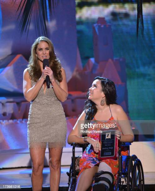 Singer Lucero presents an award onstage during the Premios Juventud 2013 at Bank United Center on July 18 2013 in Miami Florida