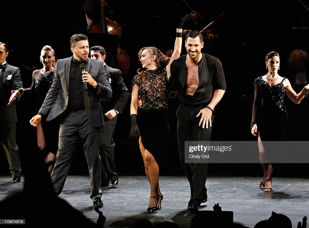 Singer Luis Enrique and dancers <a gi-track='captionPersonalityLinkClicked' href=/galleries/search?phrase=Karina+Smirnoff&family=editorial&specificpeople=4029232 ng-click='$event.stopPropagation()'>Karina Smirnoff</a> and <a gi-track='captionPersonalityLinkClicked' href=/galleries/search?phrase=Maksim+Chmerkovskiy&family=editorial&specificpeople=4251170 ng-click='$event.stopPropagation()'>Maksim Chmerkovskiy</a> take part in the 'Forever Tango' Curtain Call at Walter Kerr Theatre on July 30, 2013 in New York City.