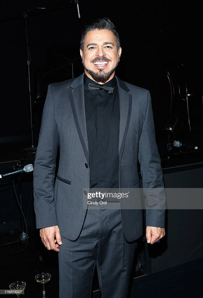 Singer Luis Enrique poses backstage following his performance with 'Forever Tango' at the Walter Kerr Theatre on July 30, 2013 in New York City.
