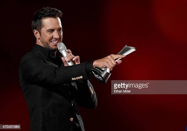Singer Luke Bryan accepts the award for Entertainer of the Year onstage during the 50th Academy of Country Music Awards at ATT Stadium on April 19...