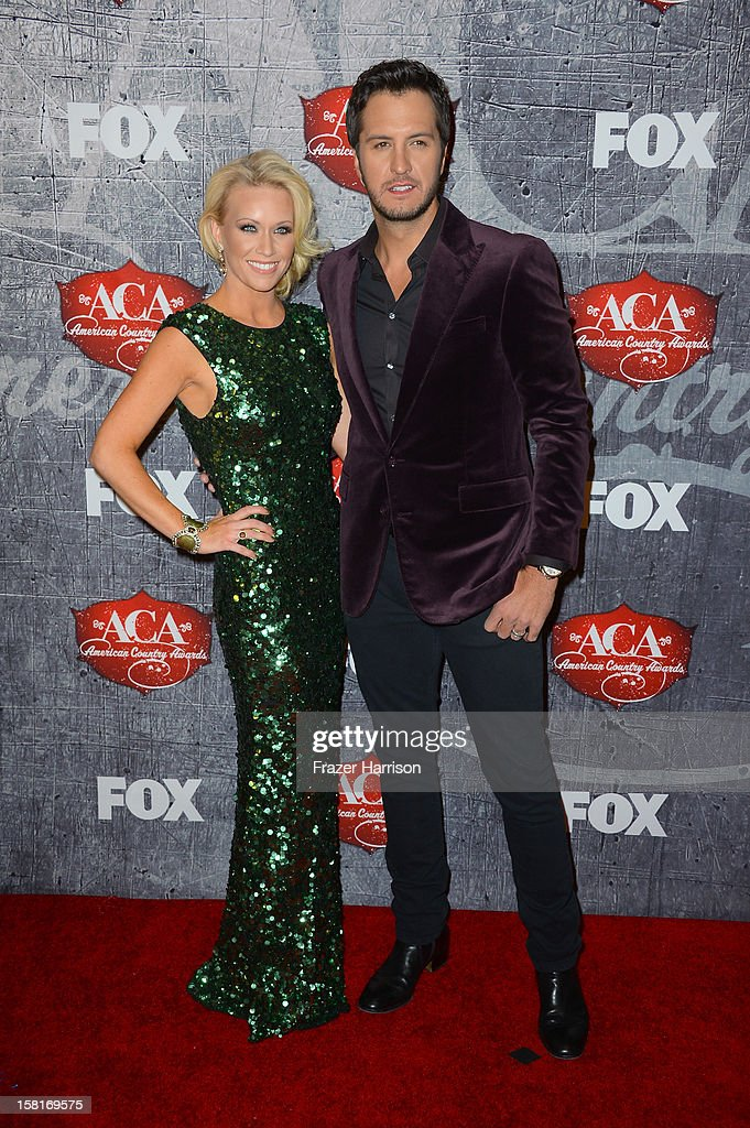 Singer <a gi-track='captionPersonalityLinkClicked' href=/galleries/search?phrase=Luke+Bryan&family=editorial&specificpeople=4001956 ng-click='$event.stopPropagation()'>Luke Bryan</a> (R) and Caroline Boyer arrive at the 2012 American Country Awards at the Mandalay Bay Events Center on December 10, 2012 in Las Vegas, Nevada.