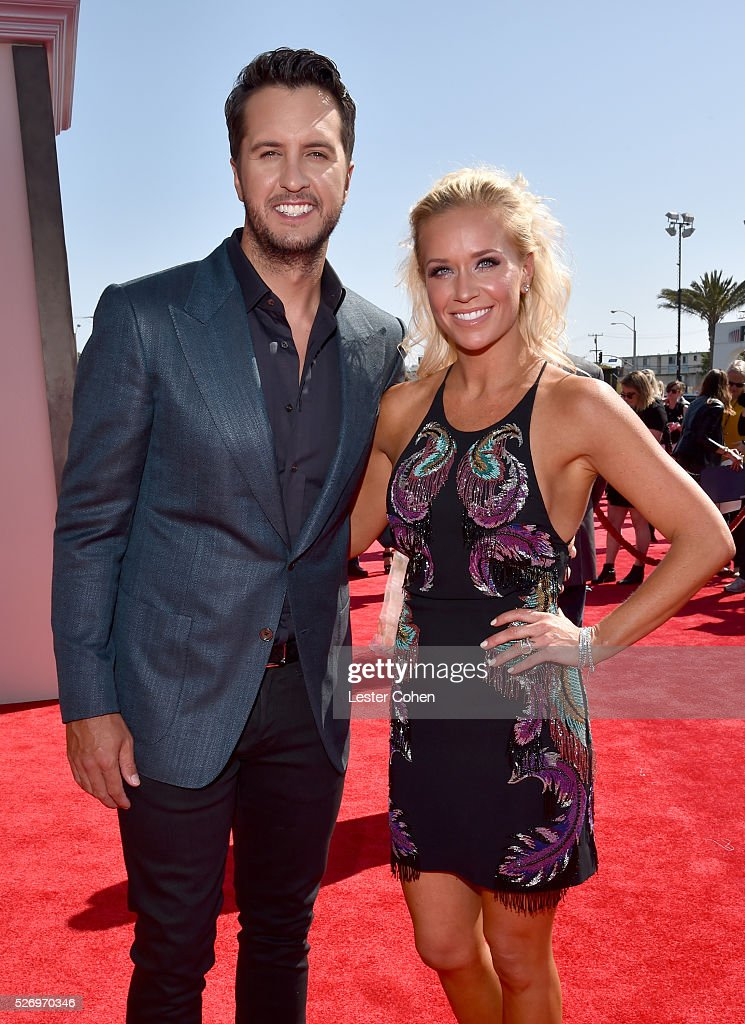 Singer Luke Bryan (L) and Caroline Boyer attends the 2016 American Country Countdown Awards at The Forum on May 1, 2016 in Inglewood, California.