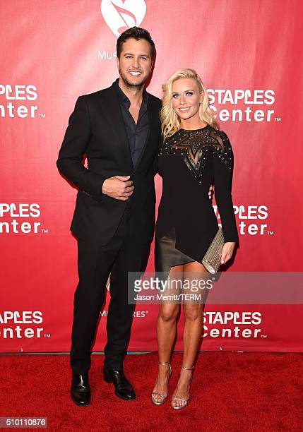 Singer Luke Bryan and Caroline Boyer Bryan attend the 2016 MusiCares Person of the Year honoring Lionel Richie at the Los Angeles Convention Center...