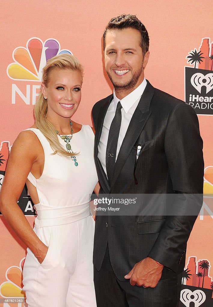 Singer <a gi-track='captionPersonalityLinkClicked' href=/galleries/search?phrase=Luke+Bryan&family=editorial&specificpeople=4001956 ng-click='$event.stopPropagation()'>Luke Bryan</a> (R) and Caroline Bryan attend the 2014 iHeartRadio Music Awards held at The Shrine Auditorium on May 1, 2014 in Los Angeles, California.